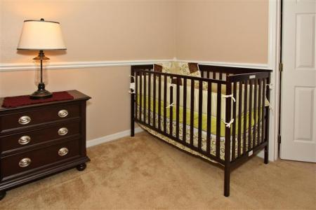 Wood Crib in King Suite 1